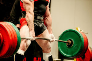 powerlifter heavy weight barbell exercise deadlift in powerlifting