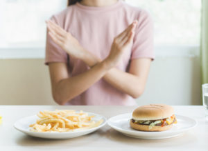 french fries and hamburger for lunh filled with saturated fat